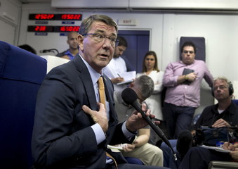 U.S. Defense Secretary Ash Carter speaks to the media on a military aircraft