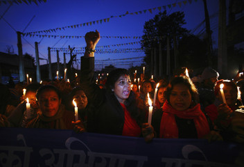 Nepalese women participate in a candle light rally to protest against what they say is an increase in violence against women in Kathmandu