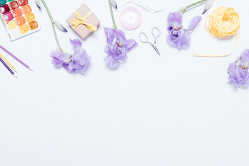 Blue flowers, watercolor paints, boxes with gift and ribbons on white background