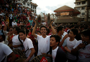 Devotees play traditional musical instruments as they take part in the Indra Jatra festival in Kathmandu