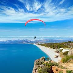 Paragliders flying above Konyaalti beach in Antalya, Turkey