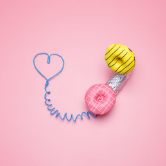 Creative Handset. Minimal concept Bright donuts on a pink Pastel Background. Symbol of love