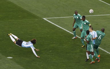 Argentina's Gabriel Heinze heads to score against Nigeria during their 2010 World Cup Group B soccer match at Ellis Park stadium in Johannesburg