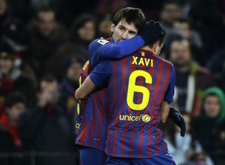 Barcelona's Xavi celebrates with team-mate Messi after scoring against Valencia during their Spanish King's Cup semi-final soccer match in Barcelona