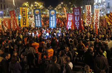 Demonstrators take part in a march during a 24-hour nationwide general strike in Barcelona