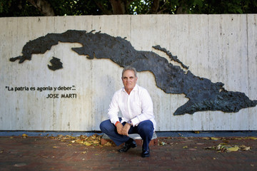 Joe Arriola, a Cuban-born former manager of the city of Miami, poses for a photo near the Bay of Pigs in Miami