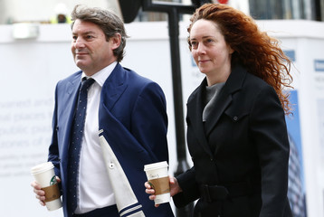 Former News International executive Rebekah Brooks and her husband Charlie arrive at the Old Bailey in central London