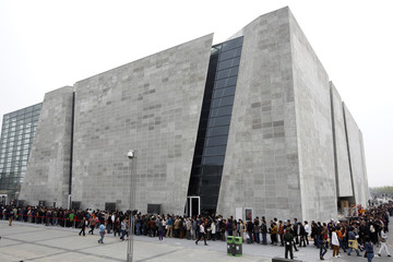 Visitors wait to enter the Italy Pavilion at Shanghai World Expo site