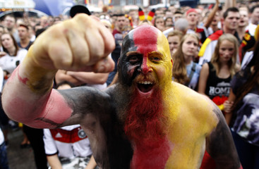 A German fan poses at a public viewing of the 2014 World Cup quarter-finals match between Germany and France in Dortmund