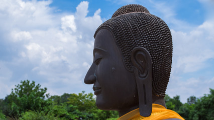 Face of black buddha statute with long ear in ancient temple, Ayuddhaya Thailand