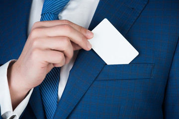 paper credit card in hand of office man, business ethics