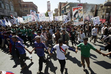 Anti-government protesters march to demand a trial for Yemen's outgoing President Ali Abdullah Saleh in Sanaa