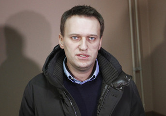 Alexei Navalny, prominent anti-corruption blogger and opposition activist, looks on before the hearings at a court session in Moscow