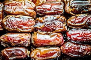Macro photo of sweet dried big dates.