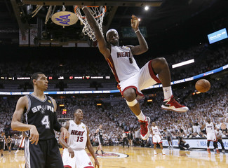 Heat's LeBron James slam dunks against the Spurs' during Game 2 of the NBA Finals in Miami