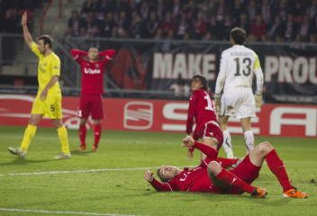 FC Twente's Janko and Ruiz react after they failed to score against Villareal during their Europa League soccer match in Enschede