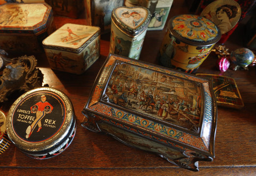 Vintage lithographed tin boxes are displayed at the house of Dardenne in Grand-Hallet