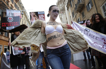 "Member of Italian group Animalisti Italiani has the words ""Fur death"" painted on her chest as she performs during a protest in Rome"