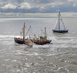 Boats and sailing ships at the Waddenzee Netherlands