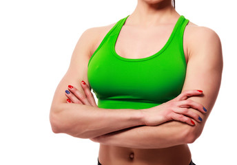 Close up shot of young sportswoman body. Fitness and healthy lady on white background, isolated