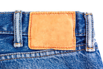 denim jeans background with blank leather label of jeans fashion design