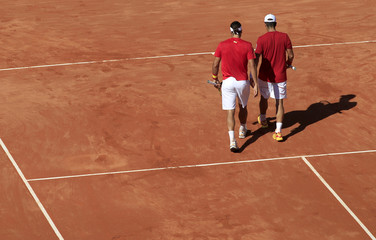 Fernando Verdasco and his team mate Feliciano Lopez of Spain walk during their doubles Davis Cup World Group semi-final rubber in Cordoba