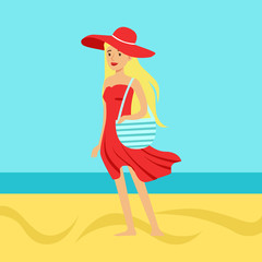 Beatuful woman in a red dress and beach hat against a bright blue sky and sea on a holiday beach