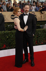 Actress Amy Adams and husband Darren Le Gallo arrive at the 23rd Screen Actors Guild Awards in Los Angeles