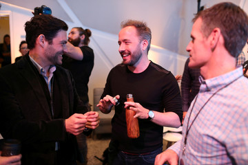 Drew Houston (2nd L), Chief Executive Officer and founder of Dropbox, converses following the cloud storage company's announcement event in San Francisco