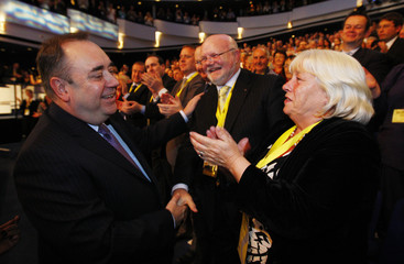 Scotland's First Minister and leader of the Scottish National Party(SNP) Alex Salmond(L) meets party suporters after his speech at their annual conference in Inverness, Scotland