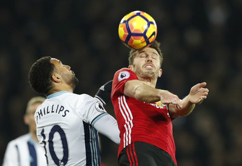 West Bromwich Albion's Matt Phillips in action with Manchester United's Michael Carrick