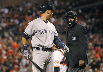 Yankees' Jeter complains to home plate umpire Hernandez after being called out on strikes during third inning of Game 2 of MLB ALDS series in Baltimore