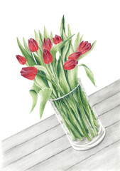Bunch of a tulips in a glass vase on a table