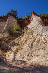 Colorful rock formations from ochre with traces of erosion in the Colorado Provencal near village Roussillon  Provence, France