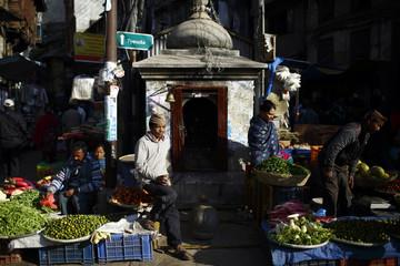 Street vendors sell vegetables at a market along the streets of Kathmandu