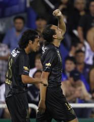 Barcos of Ecuador's LDU celebrates after scoring against Argentina's Velez Sarsfield in Buenos Aires