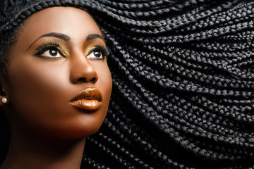 African female beauty with braided hair.