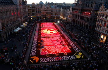 A giant flower carpet made of begonias and dahlias is illuminated at the Grand Place, celebrating the Belgo-Japanese friendship, in Brussels, Belgium
