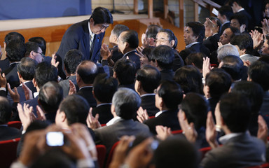 Japan's main opposition Liberal Democratic Party's lawmaker and former prime minister Shinzo Abe bows to parliamentarians of the LDP after he was chosen as the party president at the party presidential election in Tokyo