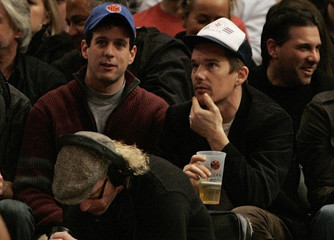 Actor Hawke watches as the New York Knicks play the Los Angeles Lakers in the second half of their NBA basketball game in New York