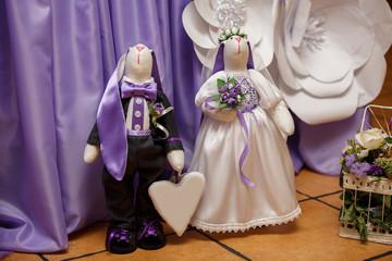 Joyful wedding couple, easter rabbits