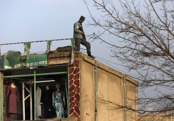 An Afghan soldier arrives at the site of a suicide attack in Kabul