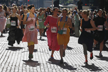 Participants leave the starting line at the annual Running with The Bridesmaids event in Boston