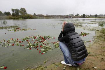 A woman grieves at the site of the Yak-42 aircraft crash in the village of Tunishna outside Yaroslavl