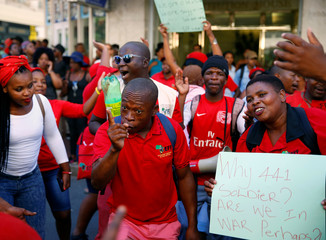 Members of the Economic Freedom Fighters (EFF) protest ahead of President Jacob Zuma's State of the Nation Address (SONA) to a joint sitting of the National Assembly and the National Council of Provinces in Cape Town