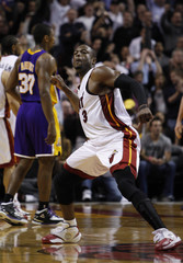 Miami Heat's Dwyane Wade reacts after sinking a basket in the fourth quarter against the Los Angeles Lakers in NBA basketball action in Miami