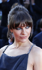 """Actress Milla Jovovich arrives for the screening of the film """"Behind the Candelabra"""" in competition during the 66th Cannes Film Festival"""