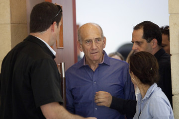Former Israeli Prime Minister Olmert leaves the court room after his hearing at the Jerusalem District court