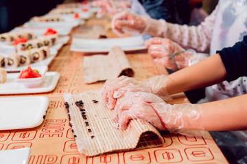 Children prepare sushi and rolls