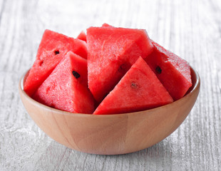 water melon in wood bowl on table